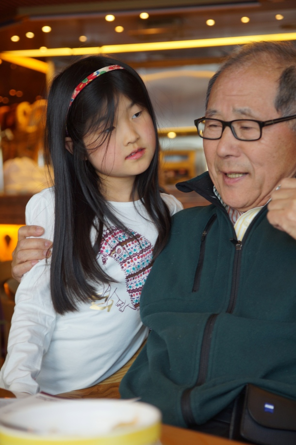 Here's Vera listening to her Grandfather tell a joke in Korean.