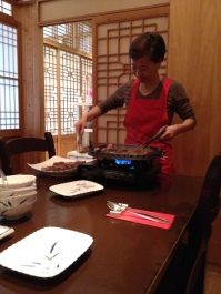 Ajuma grilling the galbi for us.